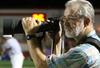 Doug_shooting_football_crop_from_mi